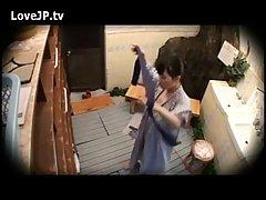 A hidden camera made a video of a sweet Japanese wife while she was doing naughty things